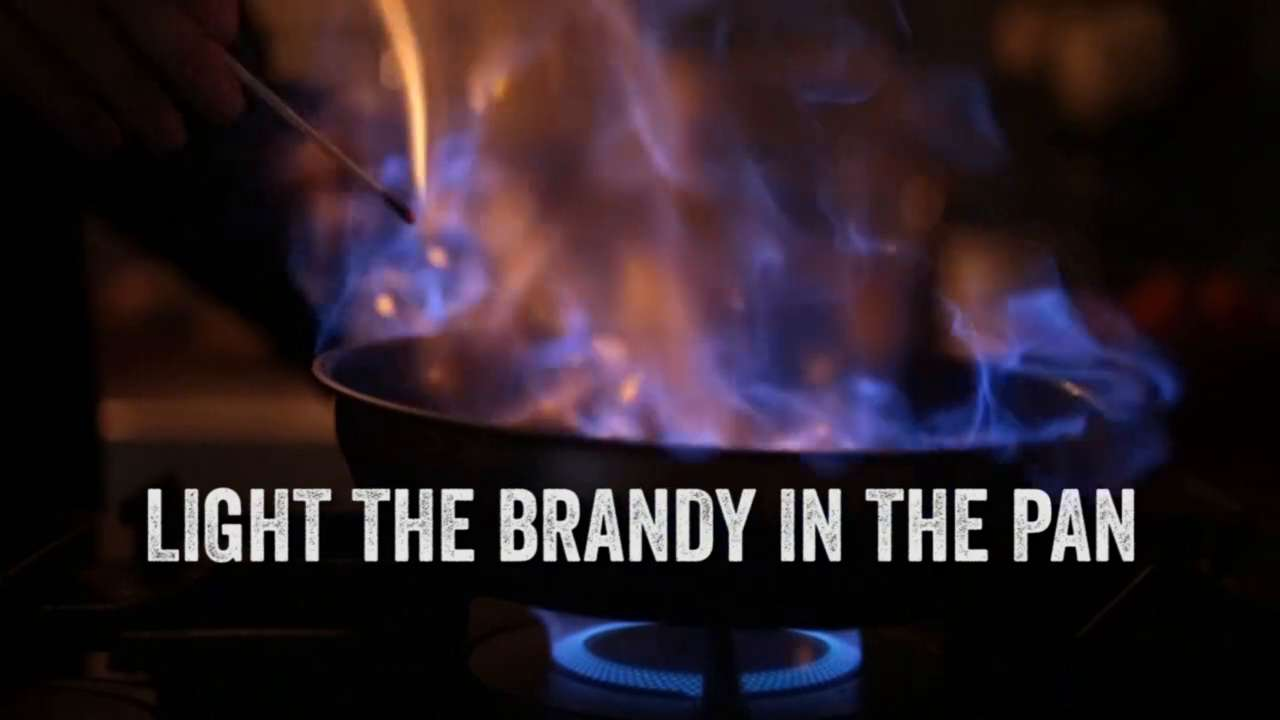 Light the brandy in the pan