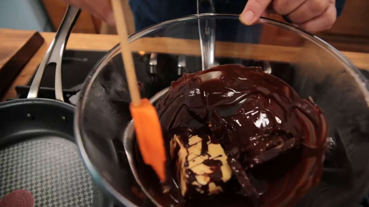 Using a silicone spatula to stir melting chocolate