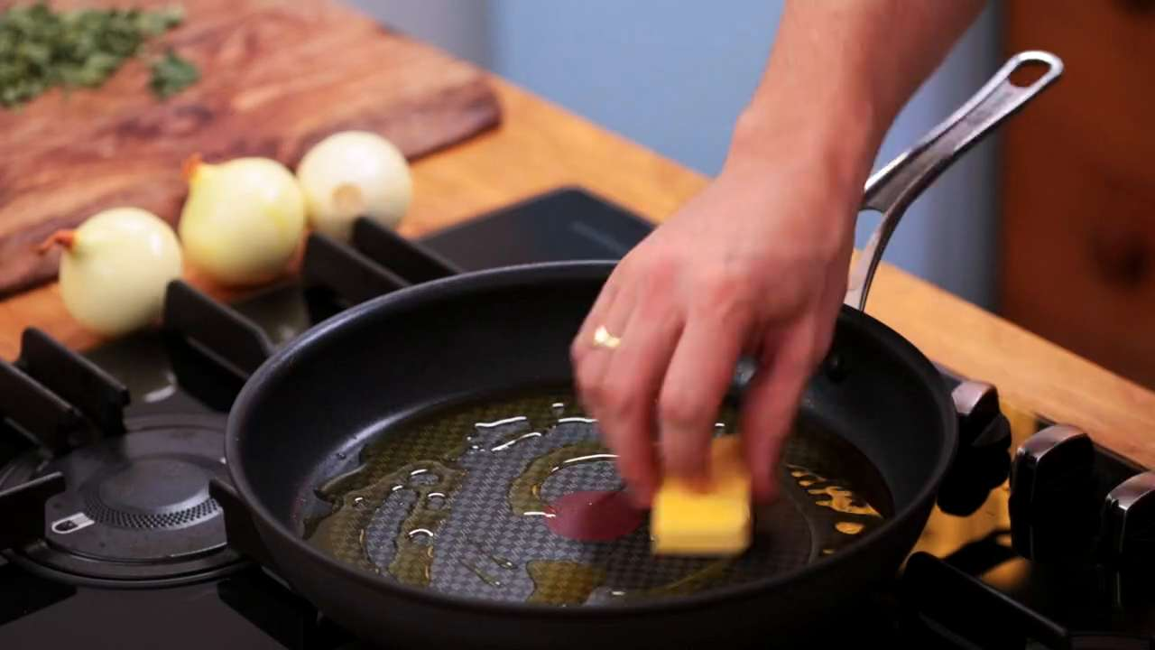 Frying the herbs in a non-stick pan