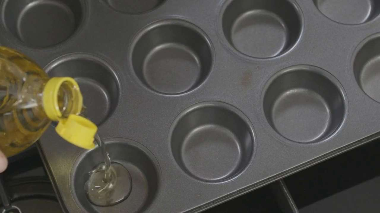 Preparing muffin tin for Yorkshire puddings
